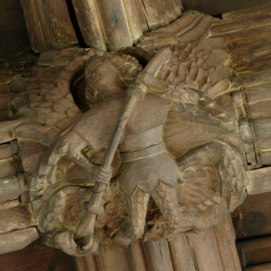St Michael slaying a dragon on the roof boss of Great St Mary's