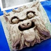 Clay gargoyle.